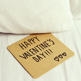 Text happy valentines day in a note Royalty Free Stock Photography