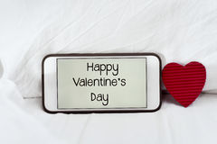 Text happy valentines day in a smartphone Stock Photo