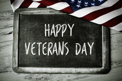 Text happy veterans day and the flag of the US stock photos