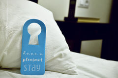 Free Text Have A Pleasant Stay In A Door Hanger Royalty Free Stock Images - 72007079