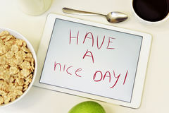 Text have a nice day in a tablet Royalty Free Stock Photo