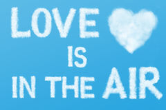 Text and heart cloud in the blue sky Royalty Free Stock Image