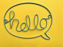 The word `HELLO` is made of blue wire. stock image