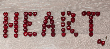Text, Herz geschrieben durch Kirsche Stockbild