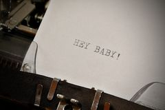 Text Hey Baby typed on old typewriter Stock Images