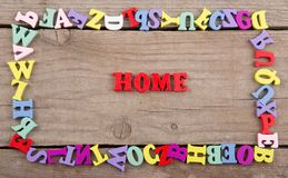 Text `Home` of colored wooden letters royalty free stock photos