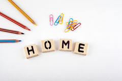 Text: Home from wooden letterson on white office desk Royalty Free Stock Photos