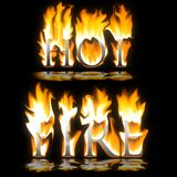 Text Hot & Fire blazing. On black background Royalty Free Stock Photo