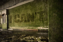Text i cant on the dirty wall in an abandoned ruined house. Text i cant on the dirty old wall in an abandoned ruined house stock photo