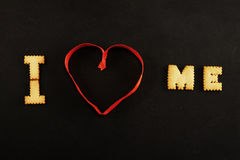 Text I heart me on black Stock Images