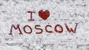 Text: I love Moscow. On snow-covered brick wall royalty free stock photo