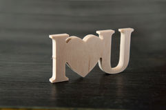 The text I love you carved out of wood paper Royalty Free Stock Photography