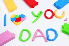 Text I love you dad made from modeling clay Royalty Free Stock Photography