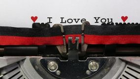 Text I LOVE YOU with hearts. Text I love You written with the typewriter on white sheet stock video footage