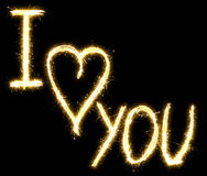 Text I love you made of sparkler. Isolated on a black background Royalty Free Stock Image