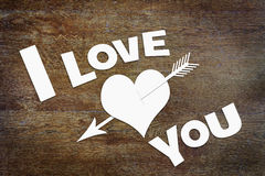 Text I Love You and a paper heart pierced by an arrow Royalty Free Stock Images