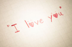 Text I love you on paper. Valentines day written Text I love you on letter sent to you Royalty Free Stock Image