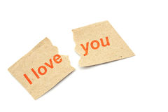 Text  i love you on torn note page Stock Photos