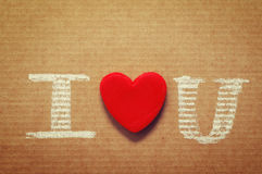 Text I love you, written in chalk on paper. Royalty Free Stock Image