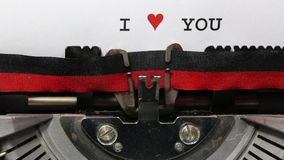 Text I Love You written with the old typewriter. On white sheet stock video