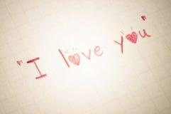 Text ich liebe dich auf Papier Lizenzfreies Stockbild