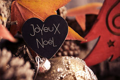 Text joyeux noel, merry christmas in french Stock Photography