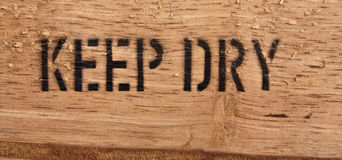 Text Keep dry on wood Royalty Free Stock Image