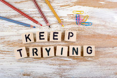 Text: Keep Trying From Wooden Letterson On Wooden Background Royalty Free Stock Photos
