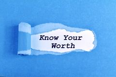 Know Your Worth. The text Know Your Worth appearing behind ripped blue paper royalty free stock images