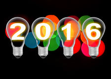 Text 2016 in lightbulb on bokeh background. S royalty free stock photo