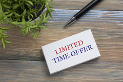 Text Limited time offer on white paper book and office supplies wood desk. Business concept Royalty Free Stock Photo