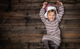 Text or logo empty copy space in vertical top view dark vintage wood.Beautiful happy child girl in homewear.Childhood. Concept.Xmas winter holiday season party stock image