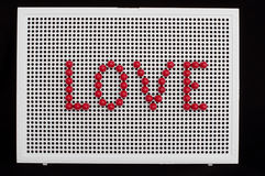 Text love on child mosaic Stock Images