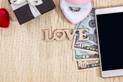 Text love with gift box, phone and dollar. Valentines concept Stock Photography