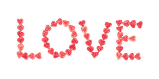 Text love with red candy hearts. Royalty Free Stock Photos