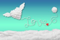 Text love with red heart from rope on blue stock image