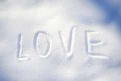 Text LOVE on the snow Stock Photo