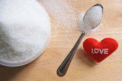 Text love with sugar in a cup on wood  background Royalty Free Stock Photography