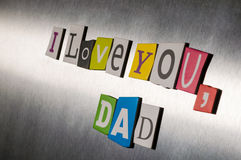 Text love you Dad for father's day  with color magazine letter clippings on short vintage metal surface. Selective focus Stock Photography