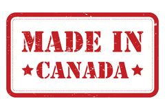 Made in Canada. Text 'made in canada' in grunge uppercase red letters inside a rectangle outlined in red, white background. Concept of rubber document stamp royalty free illustration