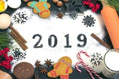 2019 text made with flour with decorations on a black background. 2019 text, snowflakes  made with flour with decorations on a black background. Flat lay. Merry royalty free stock photo