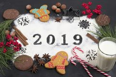 2019 text made with flour with decorations on a black background. 2019 text, snowflakes  made with flour with decorations on a black background. Flat lay. Merry stock photos