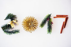2017 text made with green pine, cinnamon and golden christmas toy Stock Images