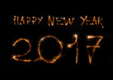 The text 2017 made of sparklers on black. The text Happy New Year 2017 made of sparklers on black background Royalty Free Stock Photography