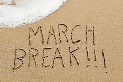 Text march break in the sand of a beach Royalty Free Stock Photography