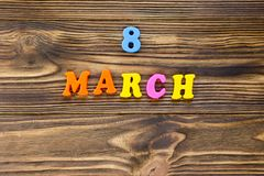 Text `8 march` of plastic magnetic letters on wooden background royalty free stock photography