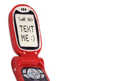 Text Me. A red mobile phone showing Text Me on the screen. This image is isolated on a white background for maximum impact royalty free stock image