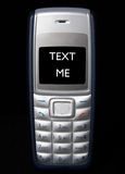 Text Me. Mobile phone showing Text Me stock photo