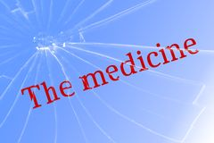 Text medicine on broken glass. The concept of quality medicines royalty free stock photography