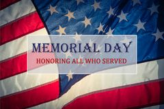 Text Memorial Day and Honor on flowing American flag background stock photo